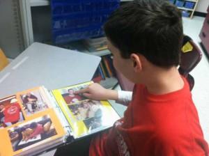 Aidan shares his photo communication book